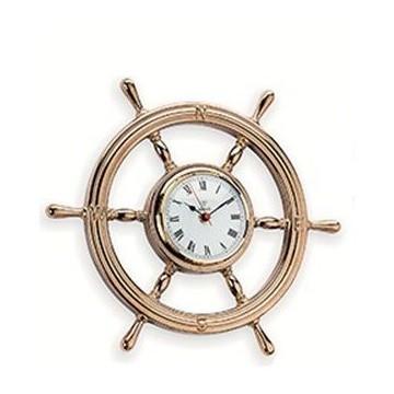Horloge en forme de barre à roue en laiton poli