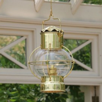 Lampe globe en laiton poli , à pètrole ou électrique